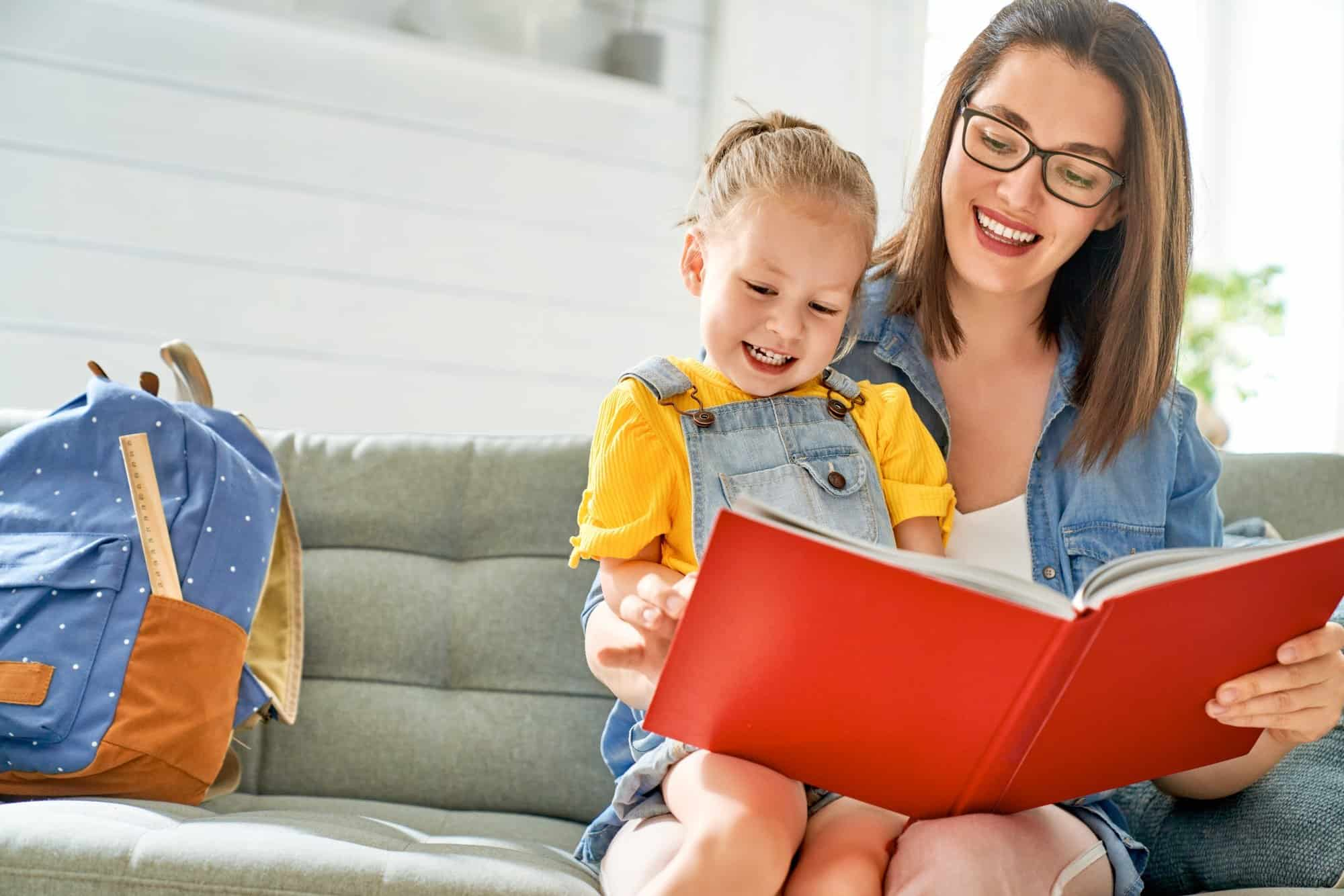 mother and daughter are reading a book.